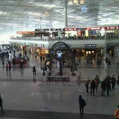 Photo taken at Beijing Capital Int'l Airport 北京首都国际机场 (PEK) by Oleg D. on 4/6/2012