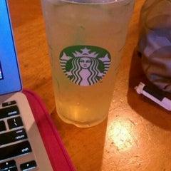 Photo taken at Starbucks by Erica L. on 7/18/2012