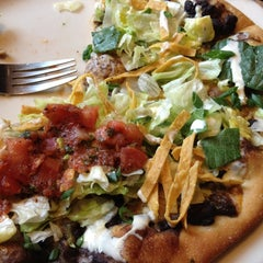Photo taken at California Pizza Kitchen by Lin W. on 2/28/2012