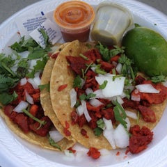 Photo taken at Al Pastor Taco Truck by Isabelle E. on 9/2/2012