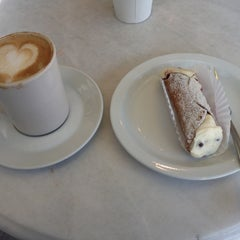 Photo taken at Stella Pastry and Cafe by Michael M. on 4/13/2012