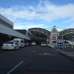 Photo taken at T1 International Terminal (SYD) by Ferdy O. on 6/6/2012