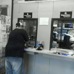 Photo taken at Currency Exchange by Sandy F. on 8/23/2012