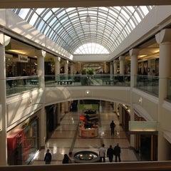 Photo taken at Metropolis at Metrotown by Alma S. on 6/9/2012