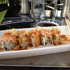 Photo taken at Moshi Sushi Bar by Christine G. on 8/21/2012