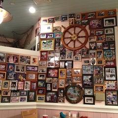 Photo taken at Olivia's Café by Thomas C. on 6/3/2012