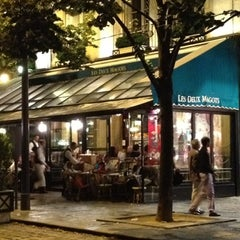 Photo taken at Les Deux Magots by Giorgio P. on 8/4/2012