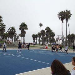 Photo taken at Venice Beach Basketball Courts by Kevin M. on 7/14/2012