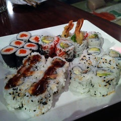 Photo taken at Juno Vancouver Sushi Bistro by Michael S T. on 9/11/2012