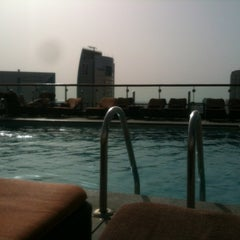 Photo taken at Hilton Dubai Roof Pool by Edward V. on 4/25/2012