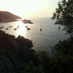 Photo taken at Scogliera di Marciana Marina by Jacopo M. on 7/20/2012