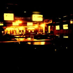 Photo taken at Pokes Bar & Grill by Hoang V. on 4/19/2012