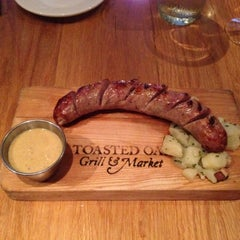Photo taken at Toasted Oak Grill & Market by Traverse 3. on 9/5/2012