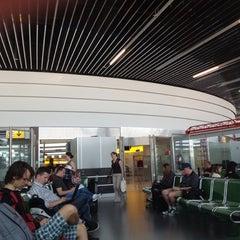 Photo taken at Gate C38 by Saki on 8/5/2012