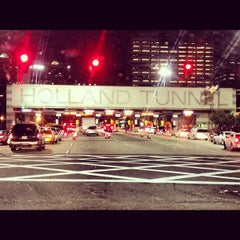 Photo taken at Holland Tunnel Toll Plaza by Jim B. on 7/23/2012