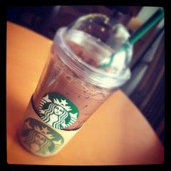 Photo taken at Starbucks (สตาร์บัคส์) by Karoon V. on 4/18/2012