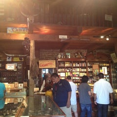 Photo taken at Racine & Larame Cigar Shop by Bethany K. on 9/3/2012
