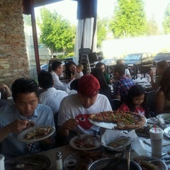 Photo taken at Stonefire Grill by Tommy S. on 6/10/2012