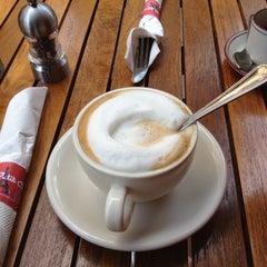 Photo taken at Mon Petit Café by Erni V. on 8/21/2012