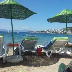 Photo taken at New Season Beach by Zeynep P. on 5/28/2012