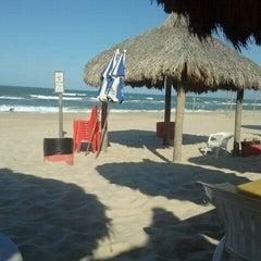 Photo taken at Barraca Terra do Sol by Eliana R. on 8/28/2012