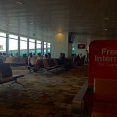 Photo taken at Gate C20 by Loo F. on 7/26/2012