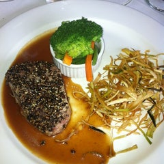 Photo taken at Viña Gourmet by Miguel on 2/22/2012