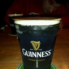 Photo taken at The Office Bar & Grill by D.j. C. on 3/17/2012