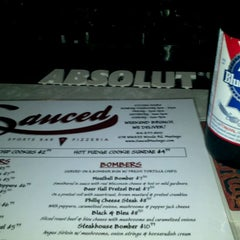 Photo taken at Sauced Sports Bar and Pizzeria by Arriel W. on 4/14/2012