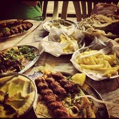Photo taken at مطعم دلق سهيل ( سوق المباركيه ) by Abdullah B. on 4/3/2012