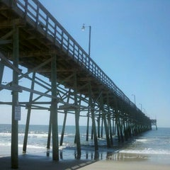 Photo taken at Oak Island Pier by Mary S. on 4/9/2012