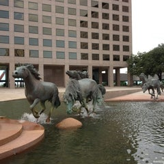 Photo taken at The Mustangs of Las Colinas by Jen D. on 6/13/2012