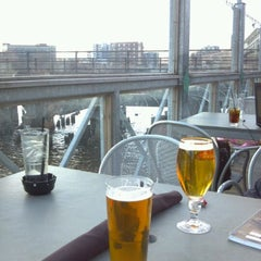 Photo taken at Riverfront Pizzeria by N on 3/14/2012
