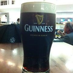 Photo taken at Tigín Irish Pub & Restaurant by Luis A. on 3/8/2012