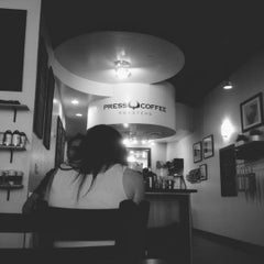 Photo taken at Press Coffee Roasters by Adam B. on 8/11/2012