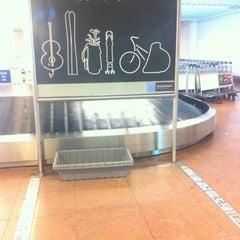 Photo taken at Arrivals (Aankomsten/Arrivées) by Sergey L. on 7/23/2012
