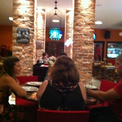 Photo taken at Divina Comédia Pizza Bar by Gustavo R. on 2/19/2012