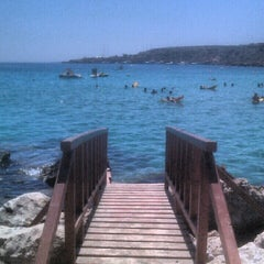 Photo taken at Konnos Beach by Dina C. on 8/25/2012