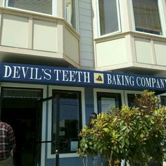 Photo taken at Devil's Teeth Baking Company by Cheryl P. on 4/28/2012