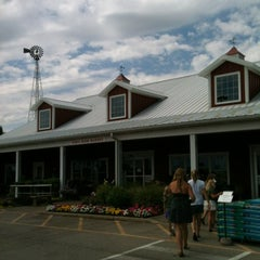 Photo taken at Tom's Farm Market & Greenhouses by Heather on 7/10/2012