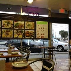 Photo taken at Moo Moo Thai Cafe by David N. on 6/12/2012