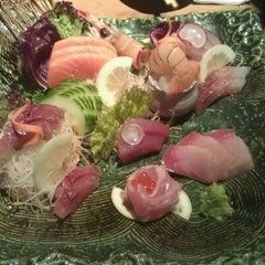 Photo taken at Kura by Joshua H. on 3/21/2012