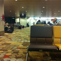 Photo taken at Gate D46 by Calyx M. on 3/12/2012