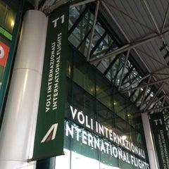 Photo taken at Terminal 1 by Fulvio M. on 3/30/2012