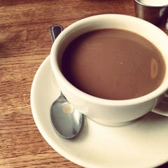 Photo taken at Il Caffe Latte by Gena B. on 4/1/2012