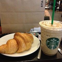 Photo taken at Starbucks (สตาร์บัคส์) by NANTAWAN O. on 3/13/2012