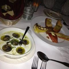 Photo taken at Tasca Spanish Tapas Restaurant & Bar by Justin on 3/8/2012