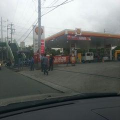 Photo taken at Shell by Santi E. on 7/20/2012