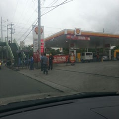 Photo taken at Shell Service Station by Santi E. on 7/20/2012