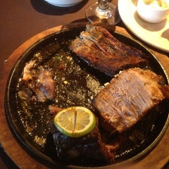Photo taken at Perry's Steakhouse and Grille by Sam B. on 3/30/2012